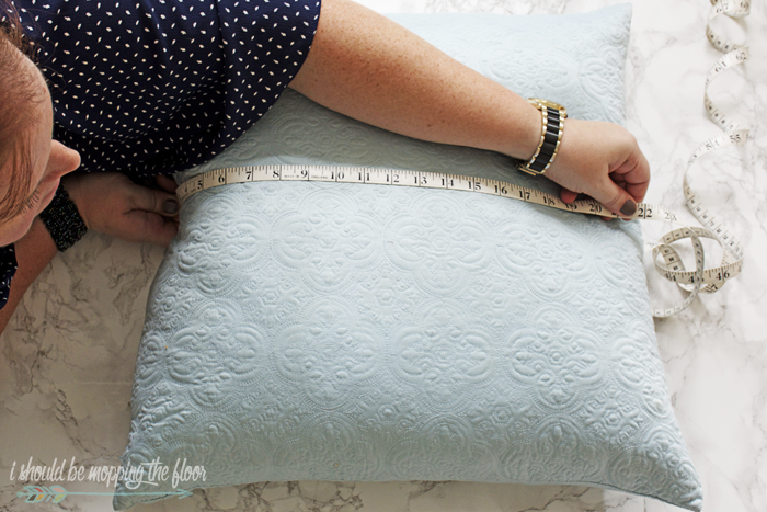 How to Make a Drop Cloth Envelope Pillow Cover | Simple beginning sewing project with step-by-step photo tutorial. These pillow covers are perfect to give ordinary pillows a festive look for the holidays.