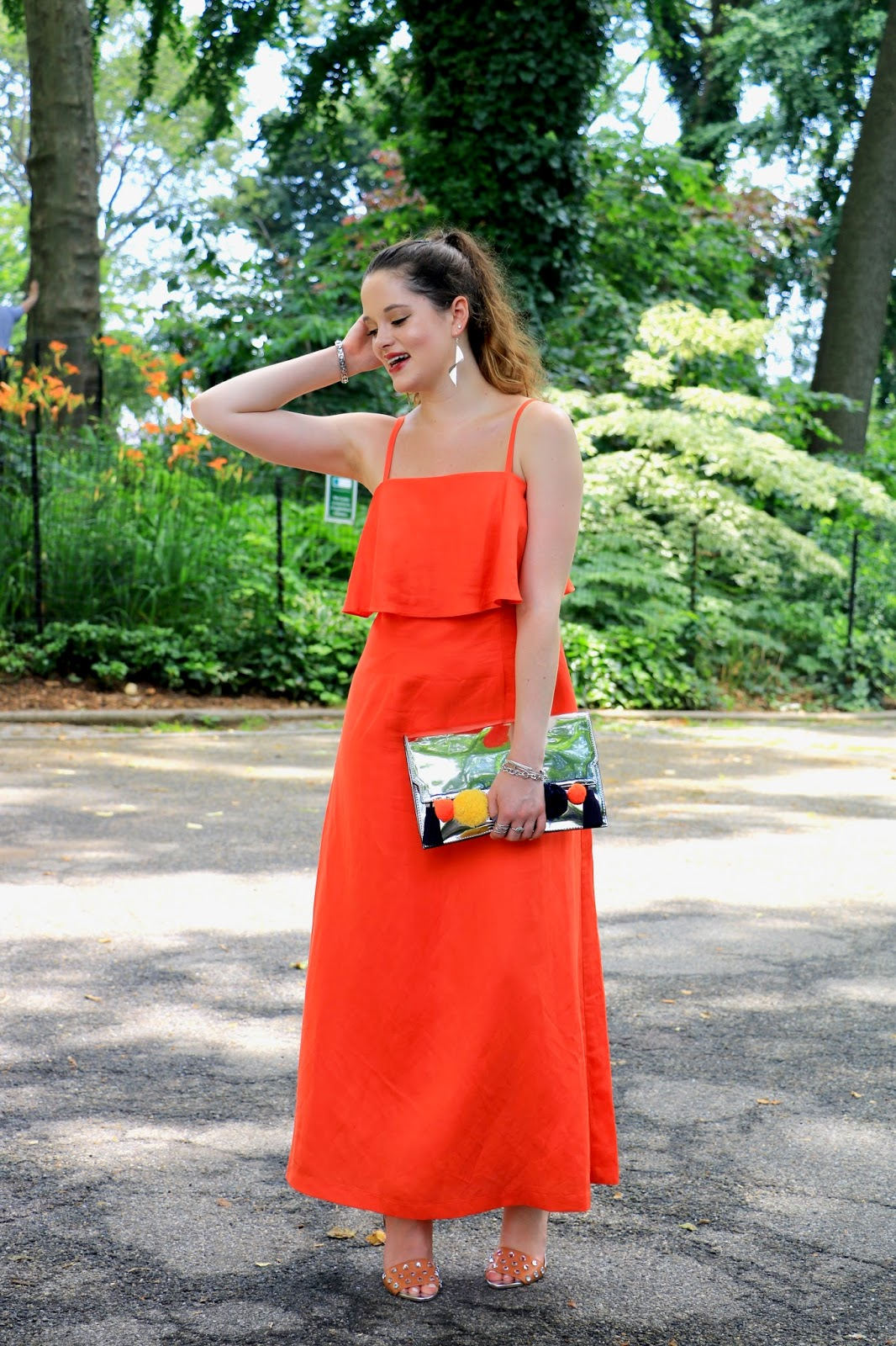 Fashion blogger Kathleen Harper of Kat's Fashion Fix showing how to wear orange maxi dress