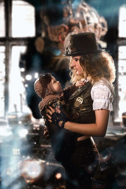 Steampunk mom in costume holding her steampunk baby. Family steampunk cosplay
