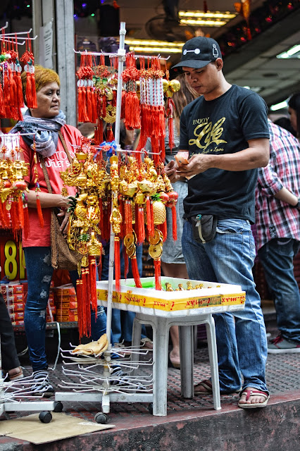 A man buying his lucky charms along Ongpin Street.