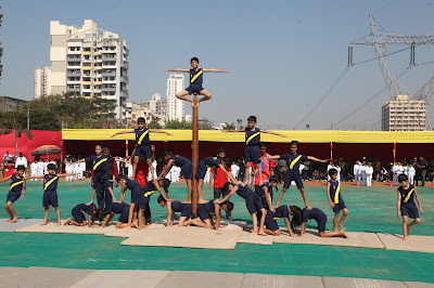 Students of Grade 3 and 4 performing Malkhamb at the Annual Sports Day at EuroSchool Airoli campus