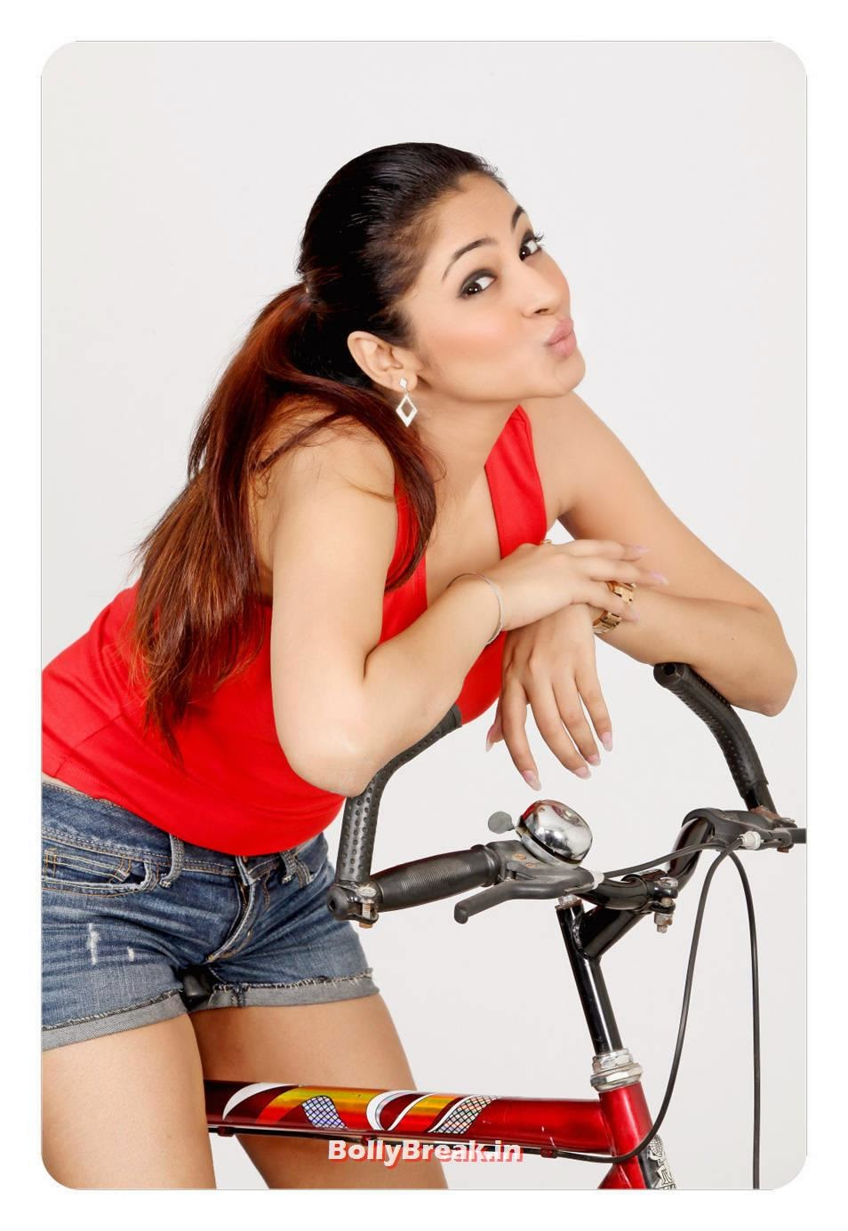 Shilpi Sharma Photo Gallery, Shilpi Sharma hot Pics with Bicycle in Red Top & shorts
