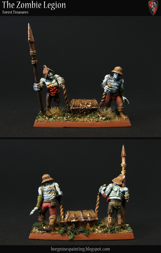 Two Zombie miniatures dragging a chest on the ground, pulling with some ropes, to be used as a unit filler - visible from the front and the back.