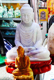 white jade Buddha with pretty carvings