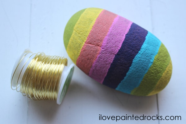Rainbow stripe painted rock for making a DIY rock photo frame