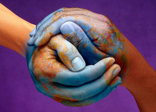 Compassion symbolized by two hands creating the world with Earth painting