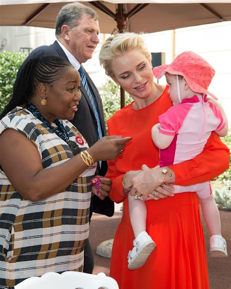 Prince Albert, Princess Charlene, Prince Jacques, Princess Gabriella of Monaco. Princess Charlene Armani Prive Dress, Jeweler diamond earrings