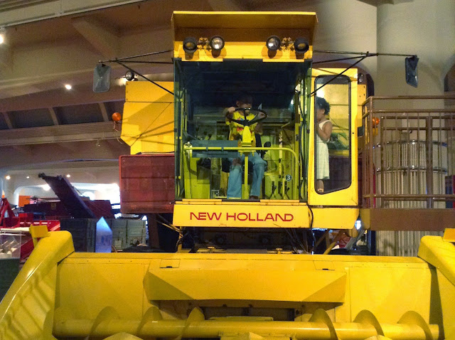 Reason 4: Hands on fun on a Tractor at Henry Ford Museum  | iNeedaPlaydate.com @mryjhnsn