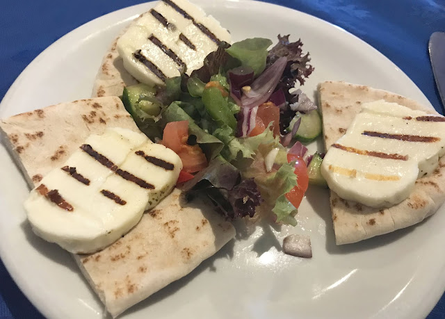 halloumi on pitta bread with salad