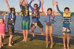 Kids jumping at camp