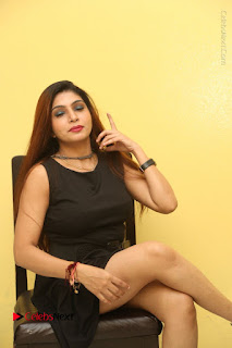 Tollywood Upcoming Actress Pooja Roshan Stills in Black Short Dress at Plus 1 Movie Trailer Launch  0275.JPG