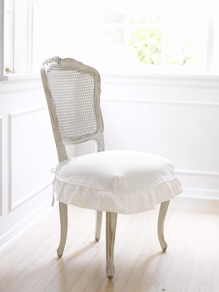White slipcovered Ella chair by Rachel Ashwell Shabby Chic