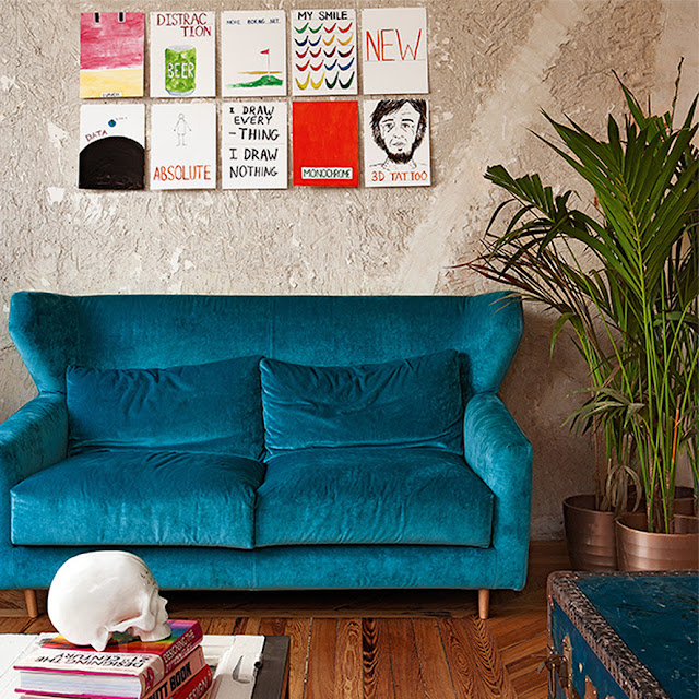 a house in Madrid, bright blue sofa