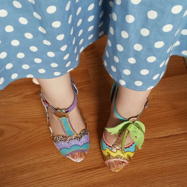 polka dot dress with mismatched tbar shoes on feet