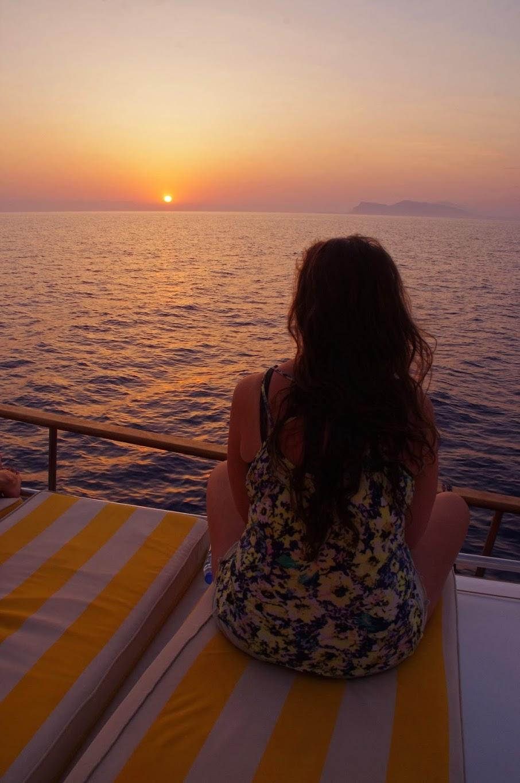 Girl sailing in Turkey at sunrise