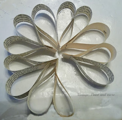 Vintage, Paint and more... 6 sets of loop units put together to form a circle for a vintage book page snowflake decoration