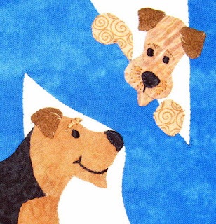 "Applique of Airedale nose-poking the letter ""N"" for Airedale Terrier rescue quilt"