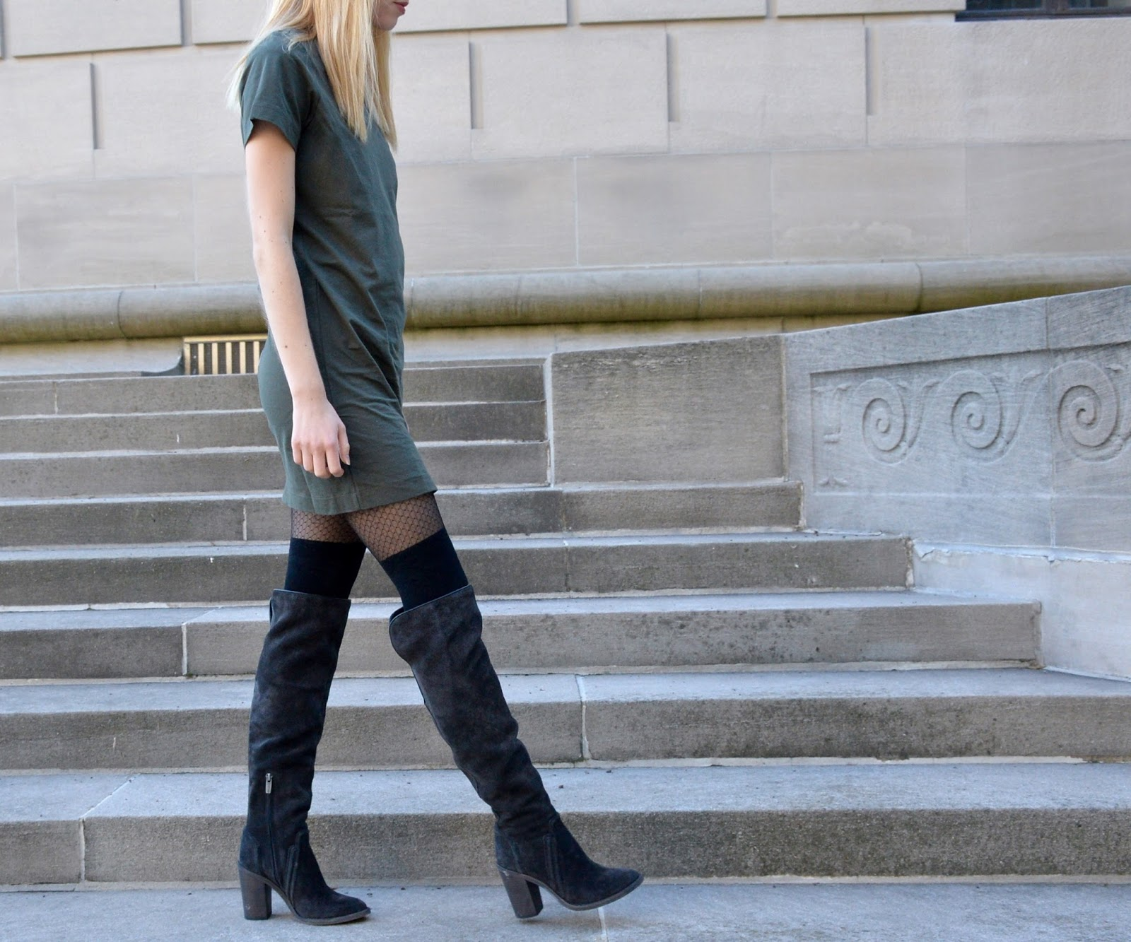 Strutting in a tee shirt dress with over the knee boots for fall