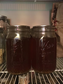Jars of home canned vegetable broth from zero waste vegan pantry https://trimazing.com
