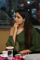 Pragya Jaiswal in a single Sleeves Off Shoulder Green Top Black Leggings promoting JJN Movie at Radio City 10.08.2017 028.JPG