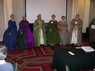 Six ladies in wrappers at the Welcome Reception.