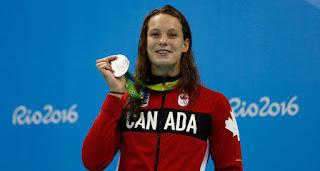 Denis Shapovalov Girfriend Penny Oleksiak Showing Off Her Medal