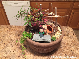Resurrection Mini Garden with crosses, symbolic plants, and empty tomb