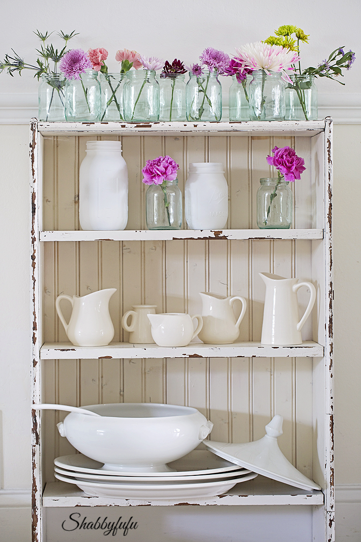 ironstone and creamware on a shelf