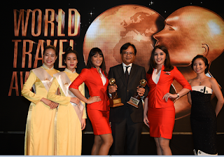 AirAsia Group CEO for Indonesia, Dendy Kurniawan receiving Asia's Leading Low-Cost Airline and Asia's Leading Inflight Service Awards on behalf of AirAsia Group at the World Travel Awards Asia & Australasia Gala Ceremony 2016 in Da Nang, Vietnam