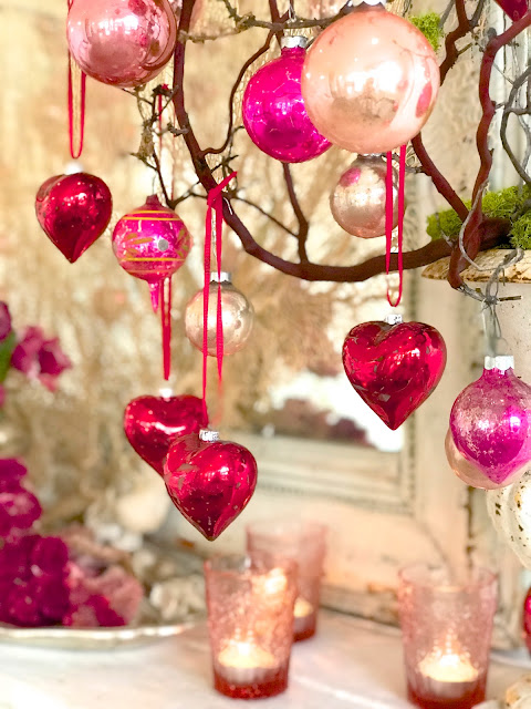 Valentine's Day Mantle Decor; Nora's Nest, pink antique ornaments, red heart ornaments, pink candles