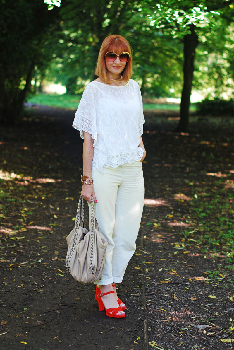 Styling summer denim: White lace top, loose jeans, orange strappy sandals, rose gold choker necklace   Not Dressed As Lamb