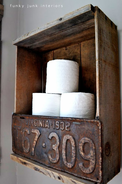 How to make this easy and cool industrial toilet paper holder crate wall shelf! Adds the perfect farmhouse charm in minutes! Click for full tutorial. #toiletpaper #shelves #storage #industrial #farmhouse #crates