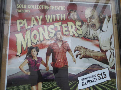 Large poster for a monster movie-type show with man and woman running in terror from a ghoul