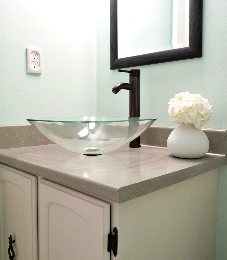 Aqua bathroom; glass vessel sink + black faucet