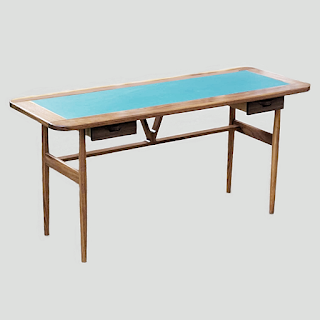 A desk with a blue leather writing surface