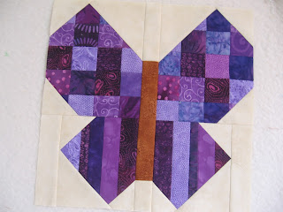 Purple scrappy butterfly quilt block