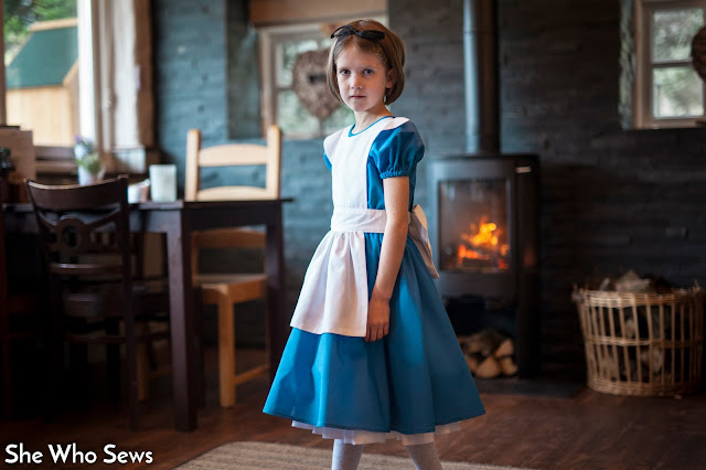 Blue dress with white pinafore
