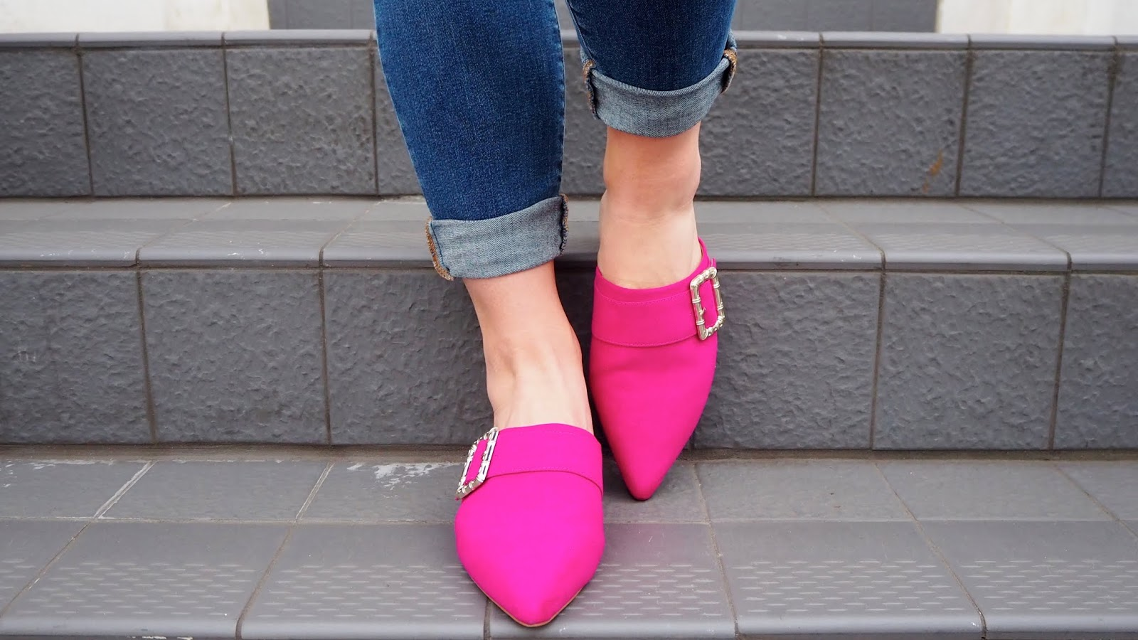 Pink pointed toe mules with silver buckles