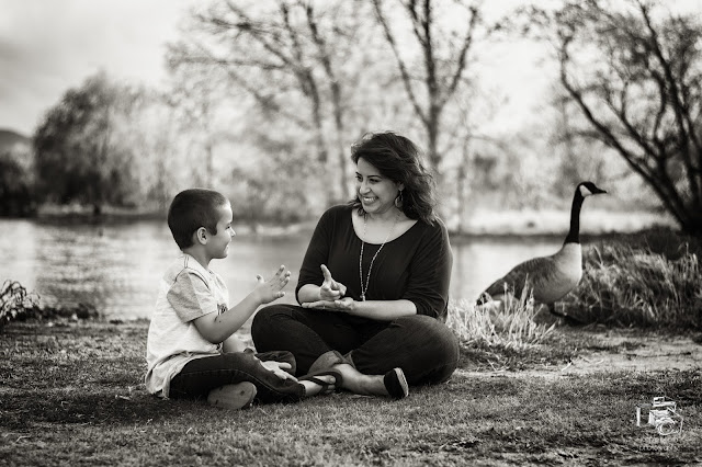 an awesome black and white photo of siblings playing during a family photo session.