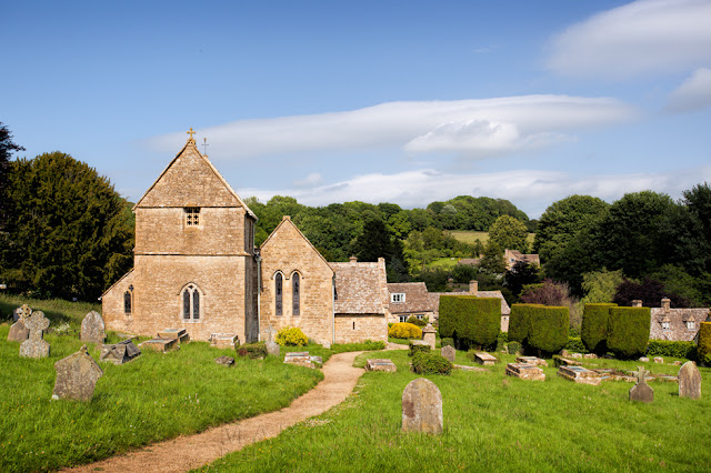 Path leads to the historic church of St. Peter's in the Cotswold village of Duntisbourne Abbots