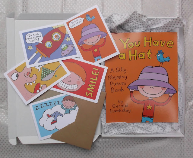 picture of picture book and five postcards