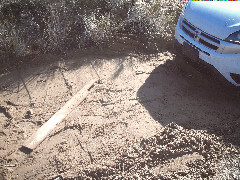 Sand leveled out flatter with board in front of van