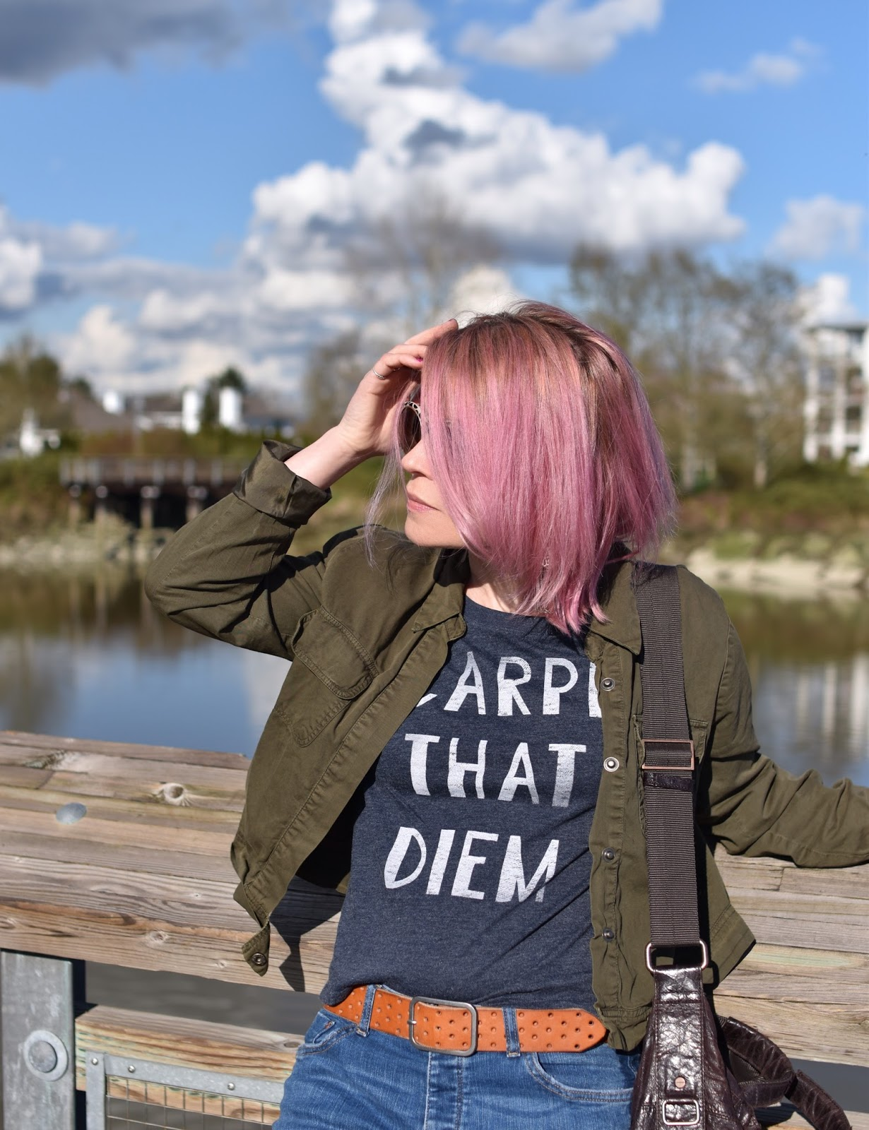 Monika Faulkner outfit inspiration - graphic tee, olive bomber jacket, pink hair