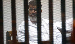 egypt-court-sentences-mursi-to-25-years-in-qatar-spy-case
