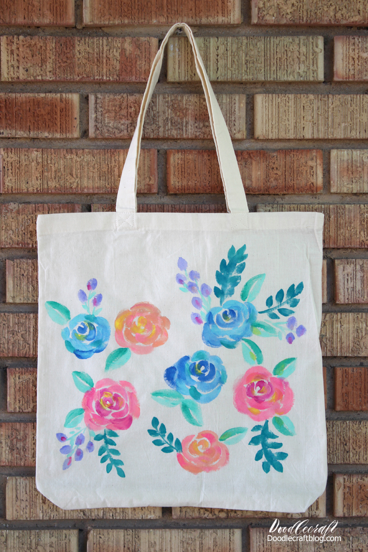 floral painted tote bag with watercolor paints and paintbrushes
