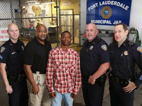 Cuffed Teen Helps Save A Cop Life