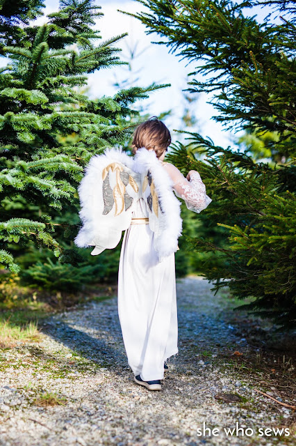 Angel costume near Christmas Trees