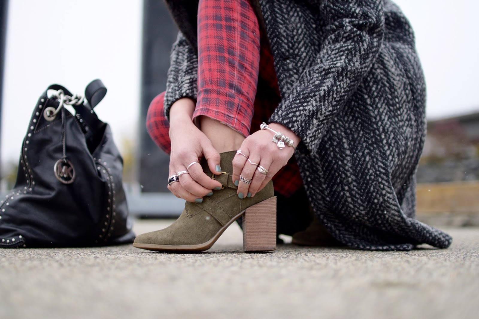 Monika Faulkner outfit inspiration - fur-collared coat, red plaid skinny jeans, olive ankle boots, MK bag