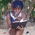 What do you think of this photo of a girl smoking and 'reading the Bible' at the same time?