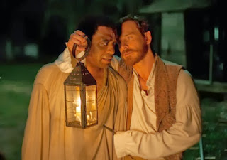 Michael Fassbender as Edwin Epps, Chiwetel Ejiofor as Solomon Northup, in 12 Years a Slave, directed by Steve McQueen